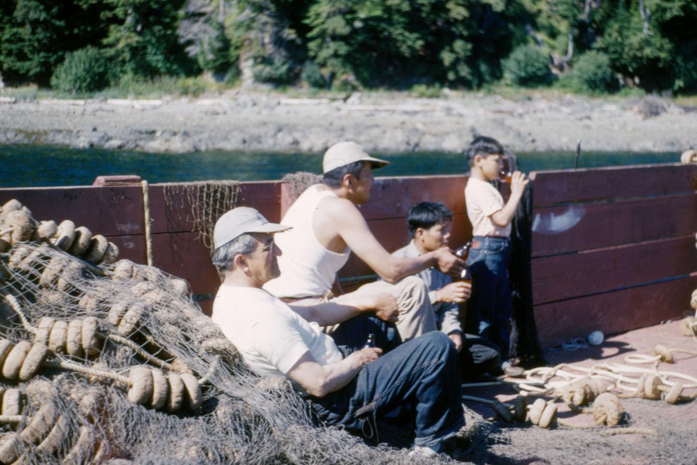 Photo by Cyrus E. Peck shows William L. Paul, Sr., Walter Soboleff, M. Quinto and Ray Peck on a seiner.