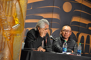 Robert Davidson speaking at SHI's recent roundtable discussion with Northwest Coast artists. At right, Earl Atchak.