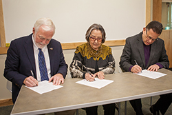 UAS Chancellor Richard A. Caulfield, SHI President Rosita Worl, and IAIA President Robert Martin signing the MOA