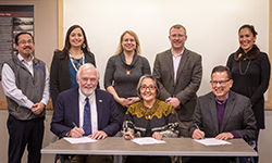 Front row: UAS Chancellor Richard A. Caulfield, SHI President Rosita Worl, and IAIA President Robert Martin; back row: UAS Vice Chancellor Joe Nelson, University of Alaska Southeast Assistant Professor of Alaska Native Studies Mique'l Dangeli, SHI Art Director Kari Groven, SHI COO Lee Kadinger, and IAIA Trustee Princess Daazhraii Johnson.